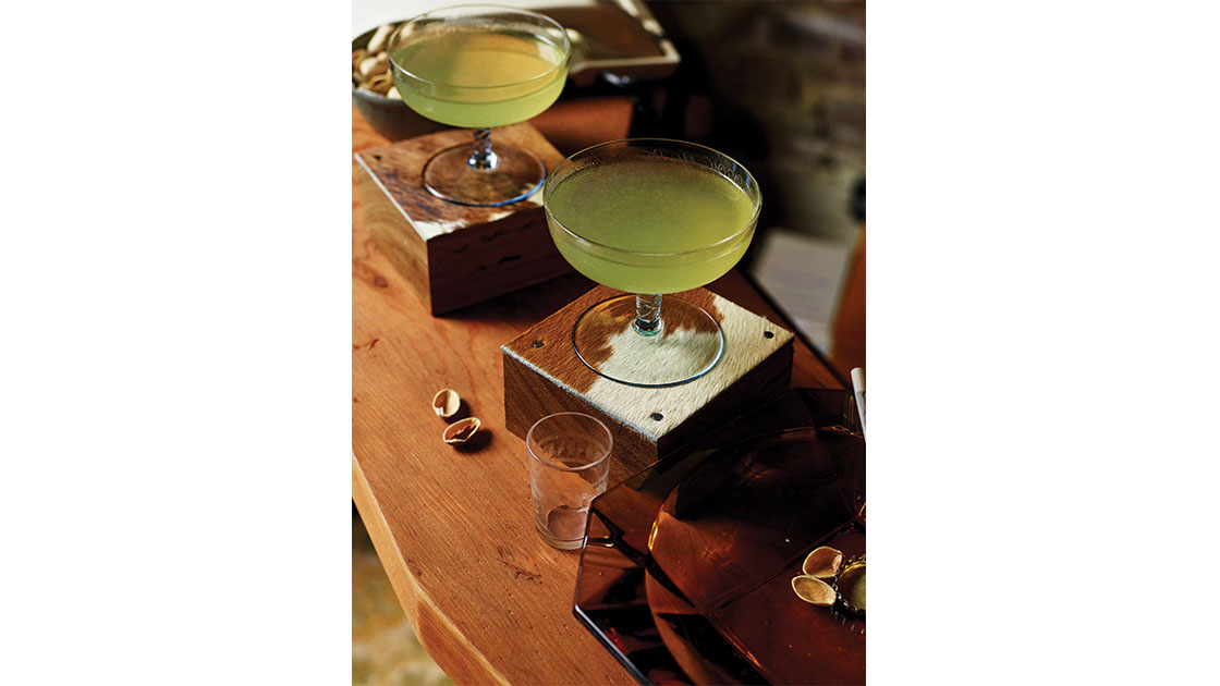 """""""The Last Word,""""  2021, Green Chartreuse, Maraschino, Hendricks Gin, lime juice, cowhide coaster, 14 x 10 x 10cm,  part of """"Play Something Else Cowboy,""""  2021, photographed by Jake Terrey"""