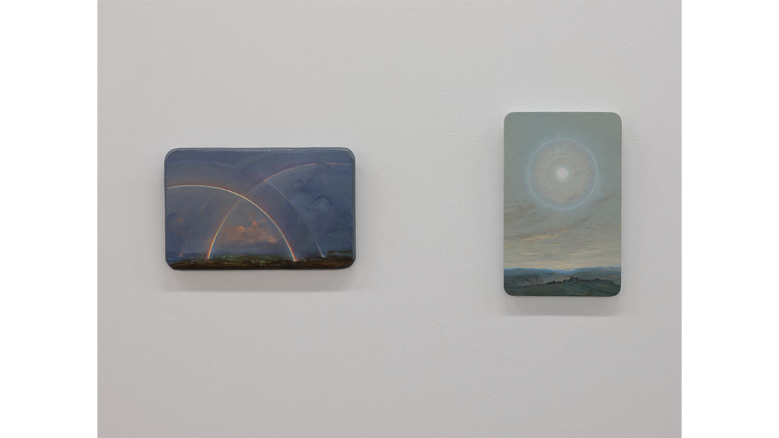 """Angela Lane, """"Phenomenon #25 (Double Rainbow),""""  2018, oil on wood, 140 x 220 mm, and  """"Parhelion,"""" 2016, oil on wood, 220 x 140 mm, courtesy Visions Gallery"""