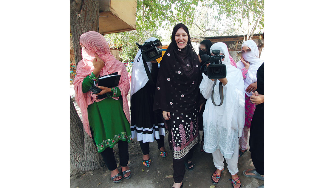 Rose with her Pashtun students at the Yellow House Jalalabad,   2016, photographed by George Gittoes