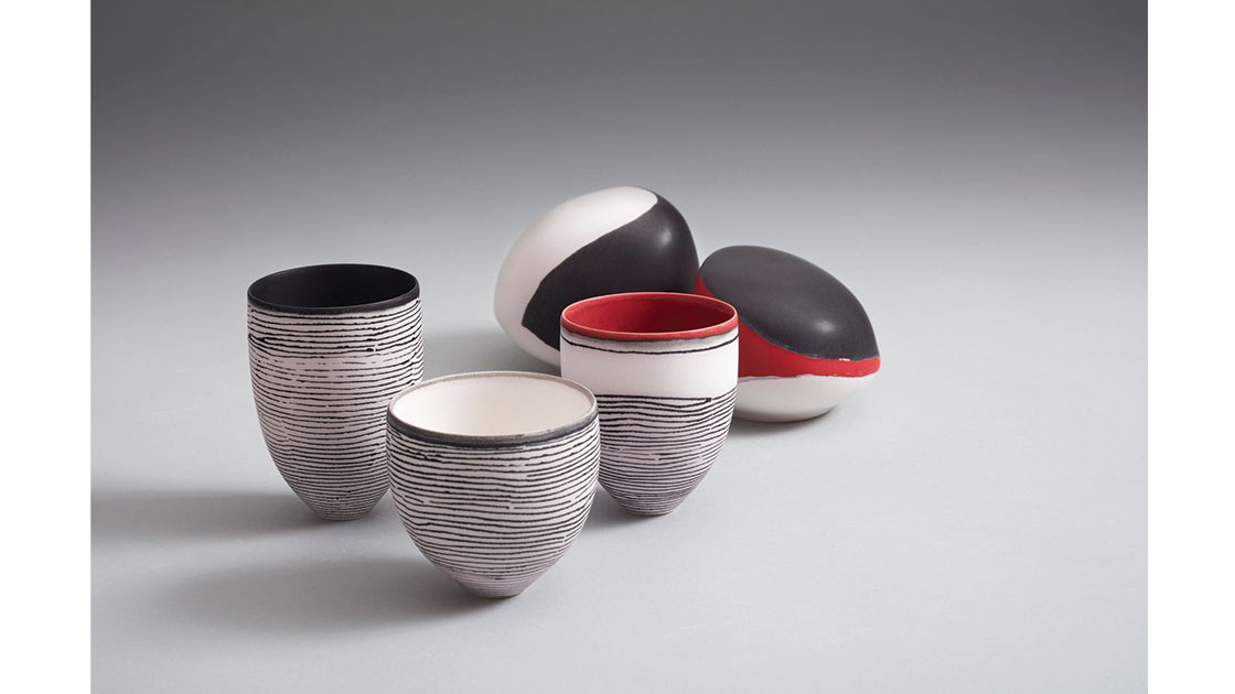 Breakaway Series II - Orca Pod, 2021,  porcelain marbles and vessels, 11.5 h –8.5h cm,  photographed by Rob Frith of Acorn Photography, courtesy Linton &  Kay Galleries