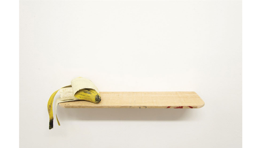 """Susan Gourley, """"Half Eaten Banana,"""" 2021, discarded polystyrene, cardboard, paper, and timber, plus modelling paste, acrylic paint, and adhesive, 16 x 42 x 10cm, photographed by Bridie Gillman, courtesy the artist and Coffs Harbour Regional Gallery"""